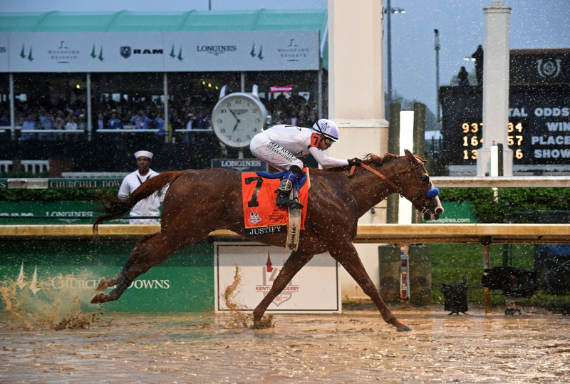 Justify, ridden by jockey Mike Smith, wins the 144th Kentucky Derby, the wettest in history, on Saturday, May 5, 2018, at Churchill Downs in Louisville, Ky. Longines, the Swiss watch manufacturer known for its luxury timepieces, is the Official Watch and Timekeeper of the 144th annual Kentucky Derby. (Photo by Diane Bondareff/Invision for Longines/AP Images)