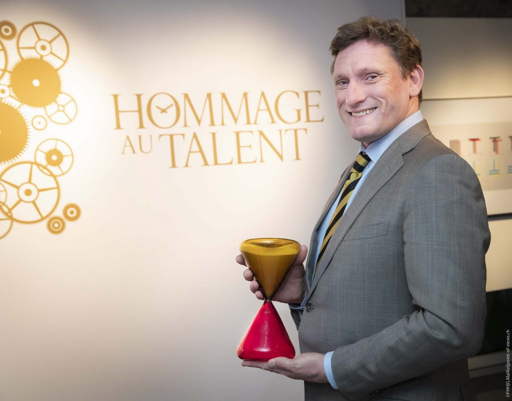 Greubel Forsey's Stephen Forsey accepts the Homage au Talent award given by the FHH.