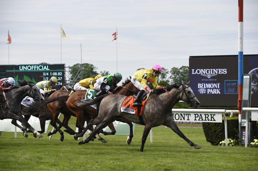 A Raving Beauty, ridden by Irad Ortiz, Jr., wins the 25th running of the Longines Just A Game race, Saturday, June 9, 2018, at Belmont Park in Elmont, NY. Longines, the Swiss watchmaker known for its elegant timepieces, is the Official Timekeeper and Watch of the 150th running of the Belmont Stakes. (Photo by Diane Bondareff/AP Images for Longines)