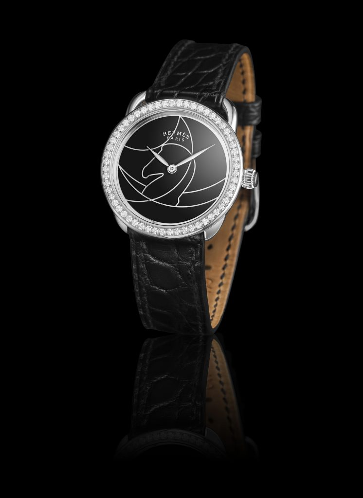 Hermes Arceau Cavils watch in black lacquer with horse motif.