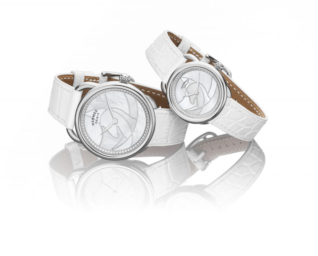 Hermes Arceau Cavils watches with white mother of pearl dial and Cavales horse motif.