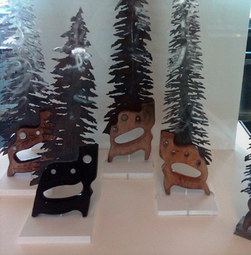 Recycled saws made into Evergreen trees.