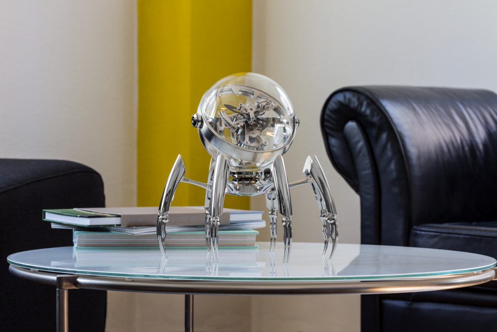 Seen here in the palladium version, the MB&F Octopod clock has legs that are adjustable to different heights.