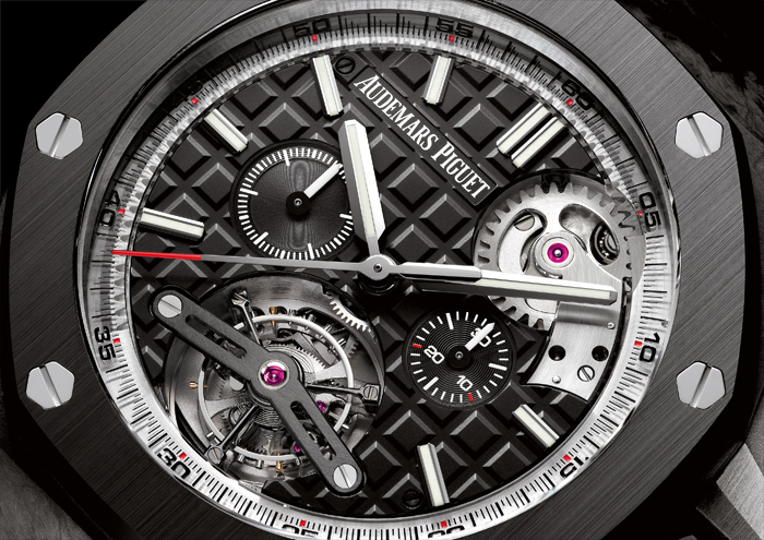 The tourbillon escapement is visible and is complemented by the Tapisserie dial.