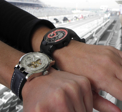 Armin Strom Racing Regulator and Manual watches on the wrist at the track.