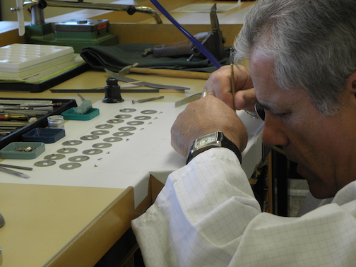 The specialists work to decorate and quality-control each movement component
