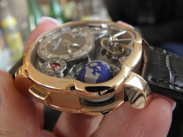 Side views of the Greubel Forsey GMT Asymetrique demonstrate its multi dimensions