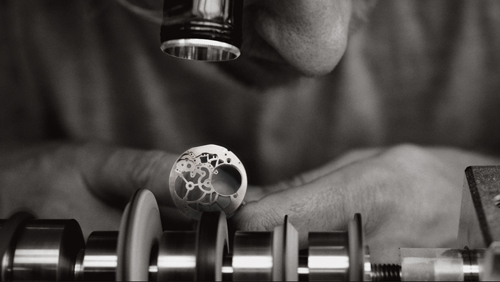 Examining the hand bevel work on an Audemars Piguet mainplate.