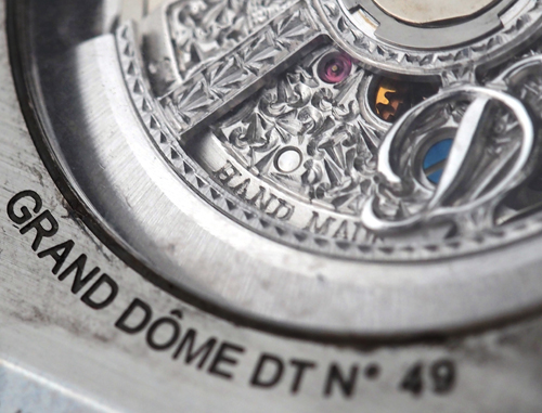 The movement of the Dubey & Schaldenbrand Grand Dome DT is intricately engraved and features the D logo prominantly.