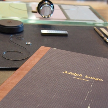 A copy of Adolph Lange's journal, with our watchmaking tools in the background