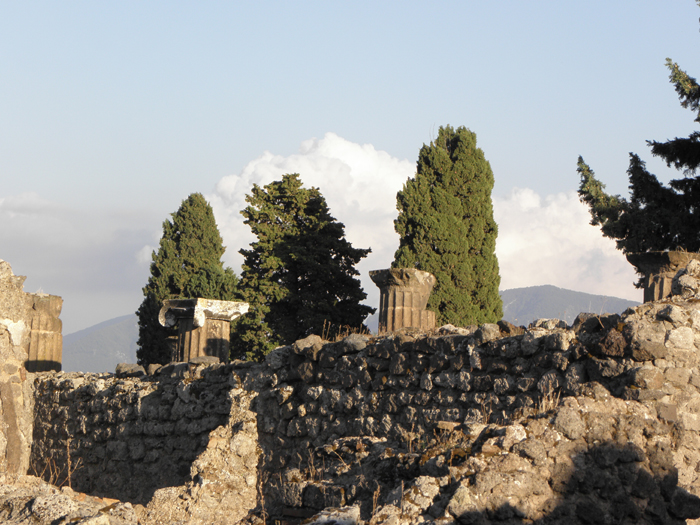 An outer wall of the city of Pompeii with Mt. Vesuvius in the background.