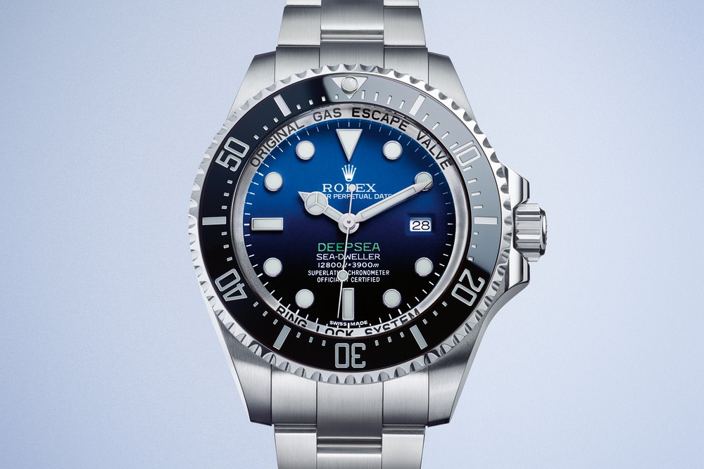 The Replica Rolex Deepsea D-Blue features a gradient dial reflecting the concept of dive, moving from blue at the top to black at the bottom. It is water resistant to 12,800 feet