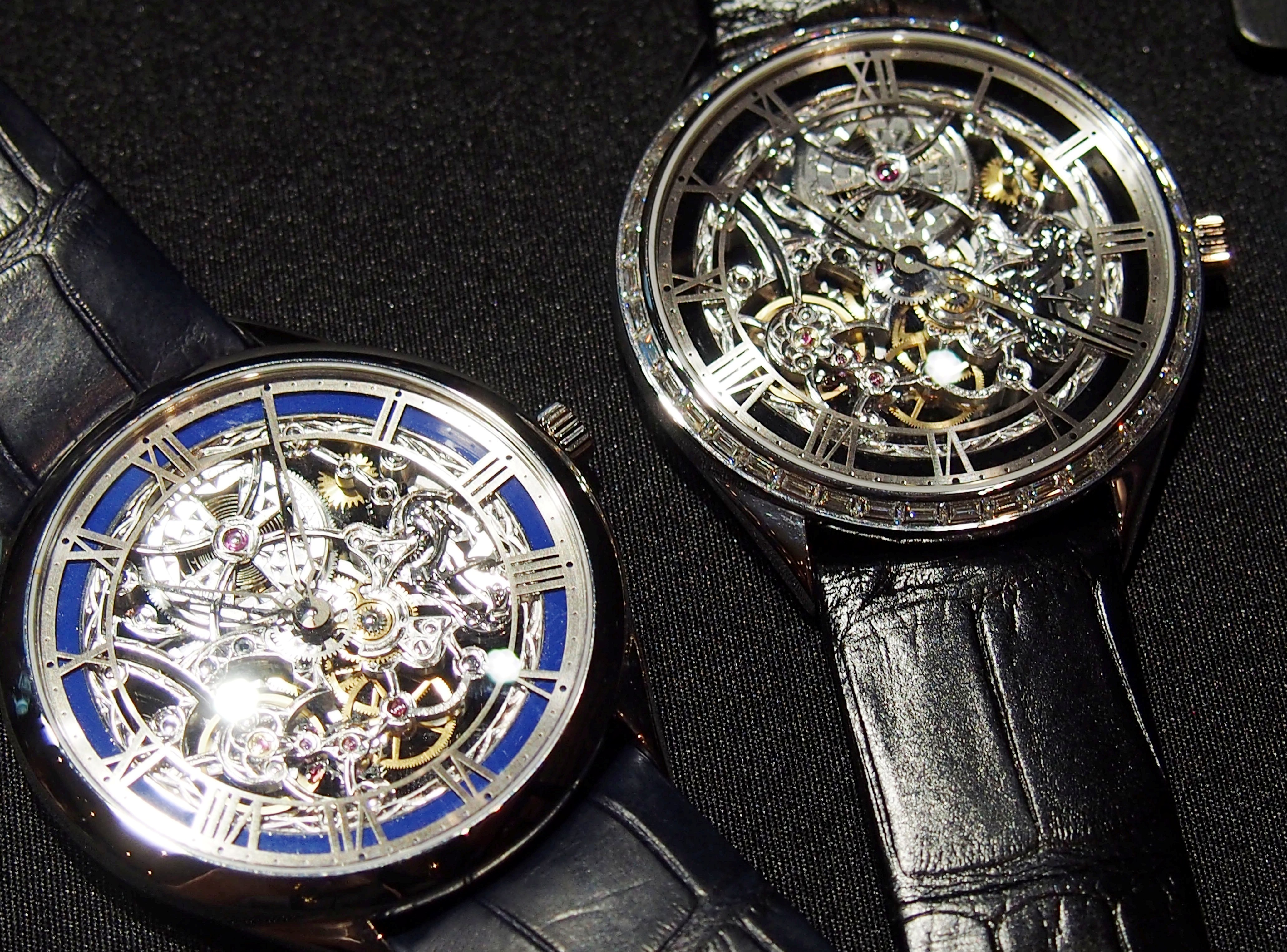 The new skeletonized watches feature blue, gray or black Grand Feu enamel inner rings.