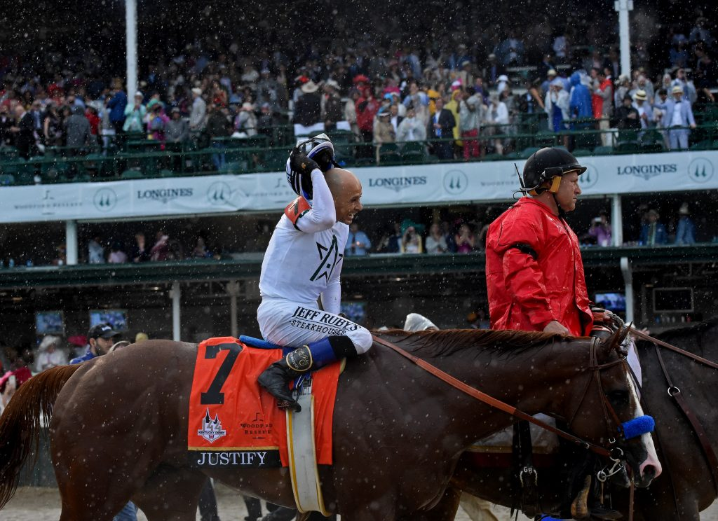 Jockey Mike Smith smiles after riding Justify to win the 144th running of the Kentucky Derby, the wettest in history, Saturday, May 5, 2018, at Churchill Downs in Louisville, Ky. Longines, the Swiss watch manufacturer known for its luxury timepieces, is the Official Watch and Timekeeper of the 144th annual Kentucky Derby. (Photo by Diane Bondareff/Invision for Longines/AP Images)