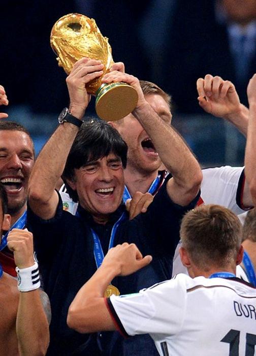 German coach wearing IWC watch