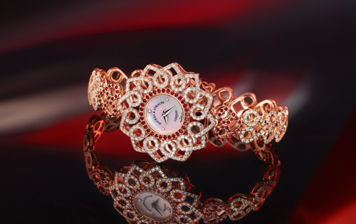 This Backes and Strauss Victoria Princess Red Heart watch was inspired by a 19th century brooch found in the company's archives.  The interlocking hearts are the focal point. The watch uses Ideal-cut diamonds and rubies.