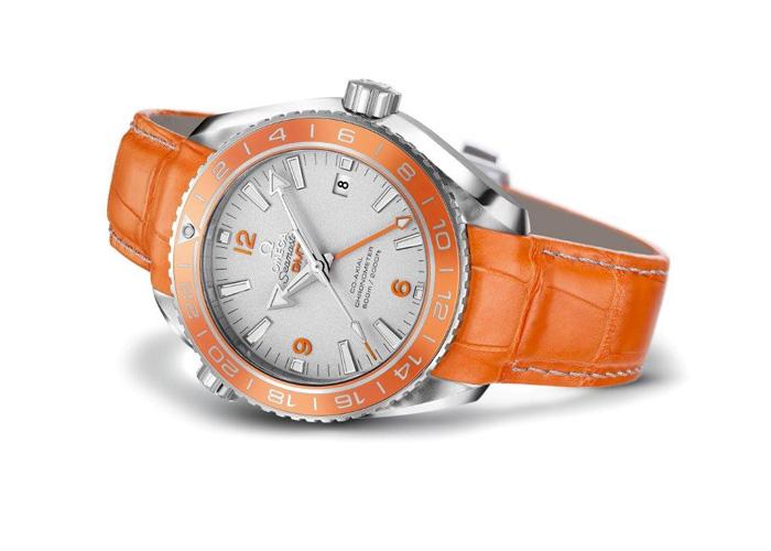 The orange ceramic bezel features LiquidMetal(R) platinum numerals, divisions and ring.