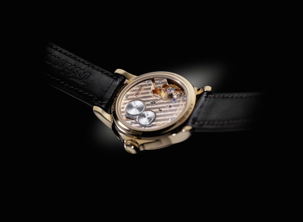 The exquisite German-made movement of the Tutima Patria is visible via a transparent sapphire casebook.