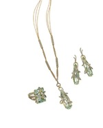 Alluring green beryl Stiletto pieces accented with diamonds