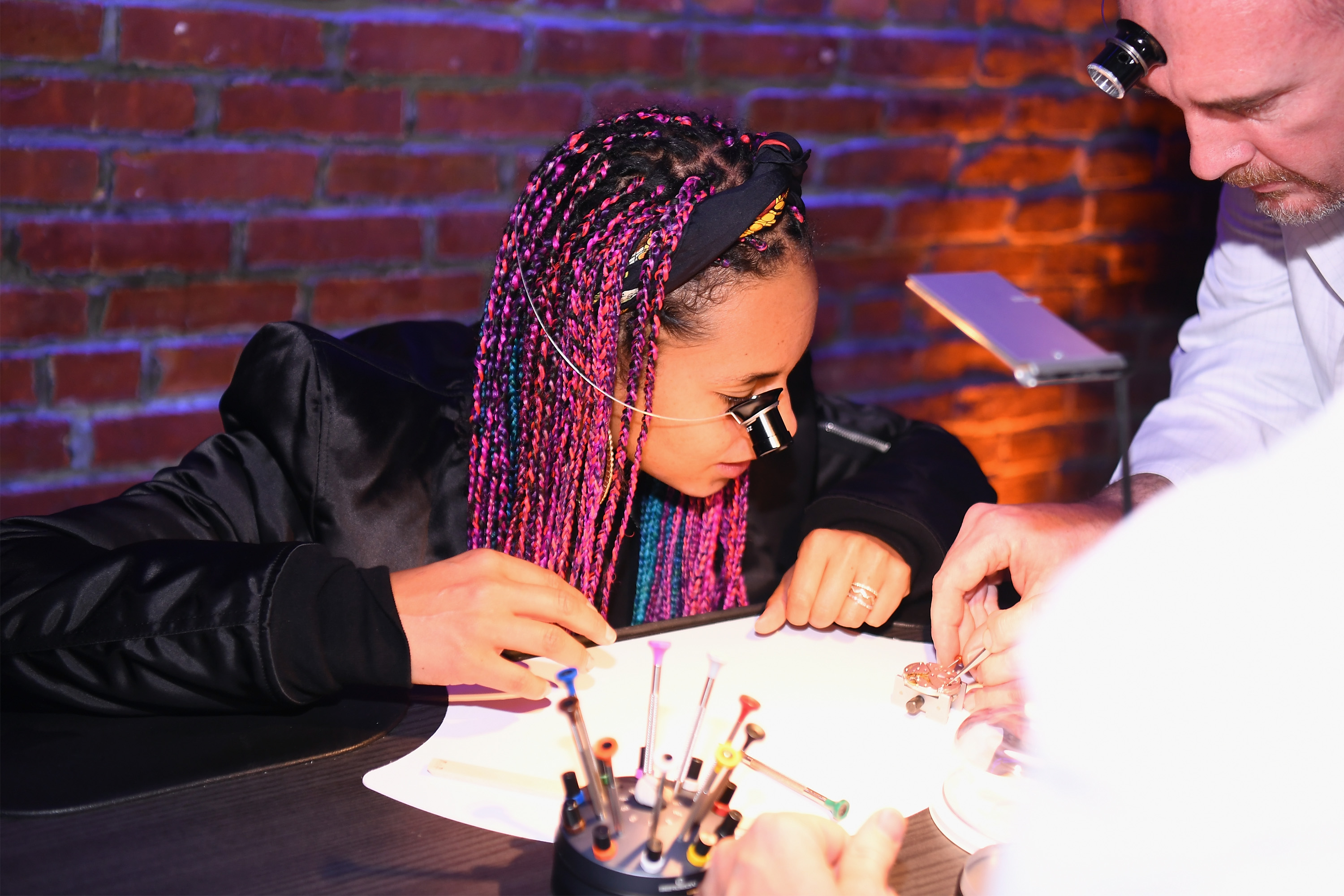 Alicia Keys learns from a watchmaker as Zenith Watches and Swizz Beatz celebrate the launch of The Defy Collection at the Angel Orensanz Center on November 30, 2017 in New York City. (Photo by Dave Kotinsky/Getty Images for Zenith)