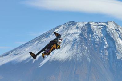 Jetman wears a jet-powered wing in flight.