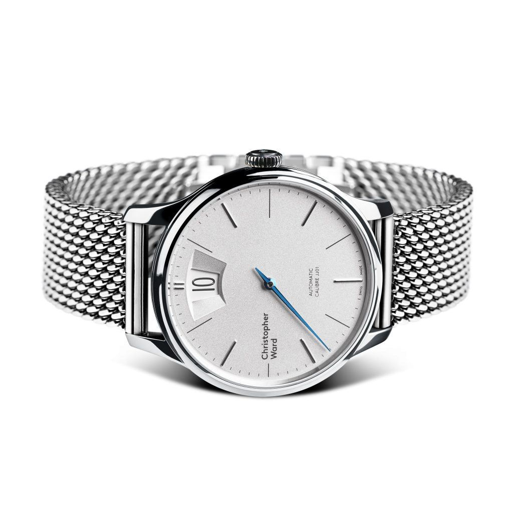 Christopher Ward C1 Malvern Jumping Hour watch on Milanese mesh bracelet.