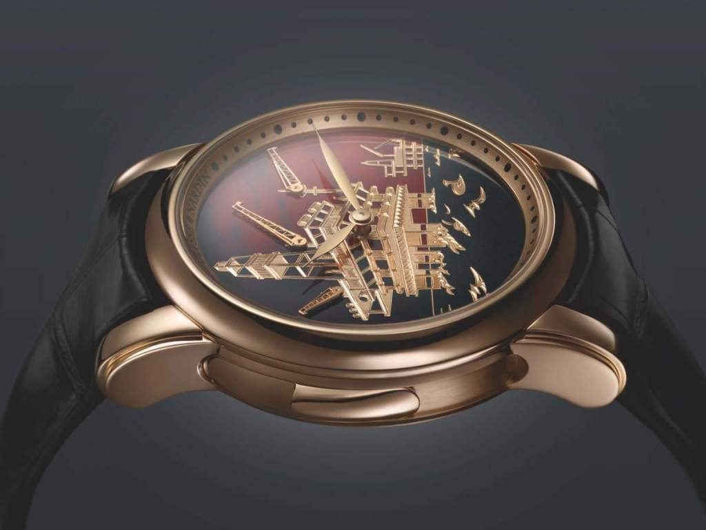 The dial of the Ulysse Nardin North Sea Minute Repeater features a carved 18-karat gold oil rig and a champleve enamel background.
