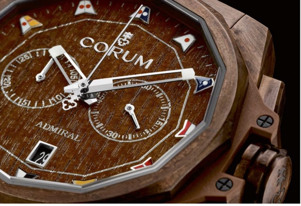 The dial of the Corum AC-One Bronze Chronograph is crafted of real teak wood and features nautical pennants as markers.