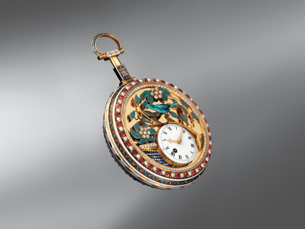 The concept of adorning the watch with rubies and pearls stems from earlier gemstone adorned pocket watches such as this from the brand.