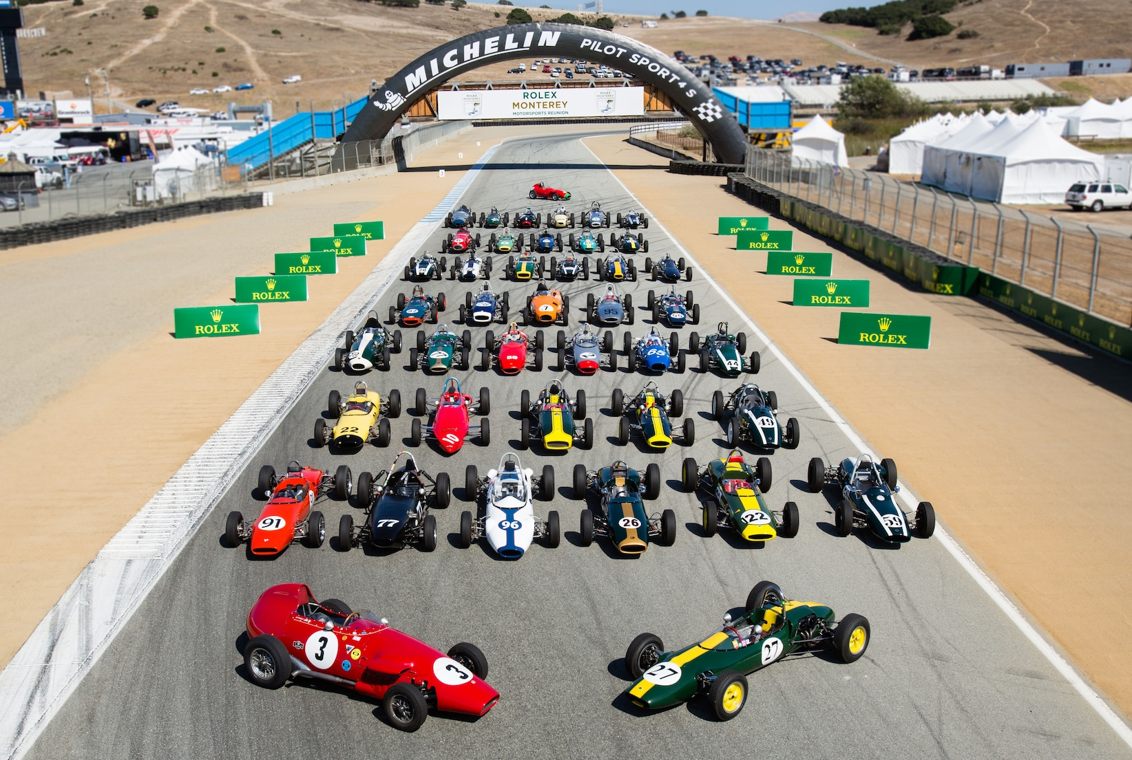 Cars line up at the Rolex Monterey Motorsports Reunion