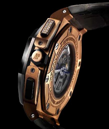 The watch houses a proprietary mechanical movement, visible via a sapphire caseback.
