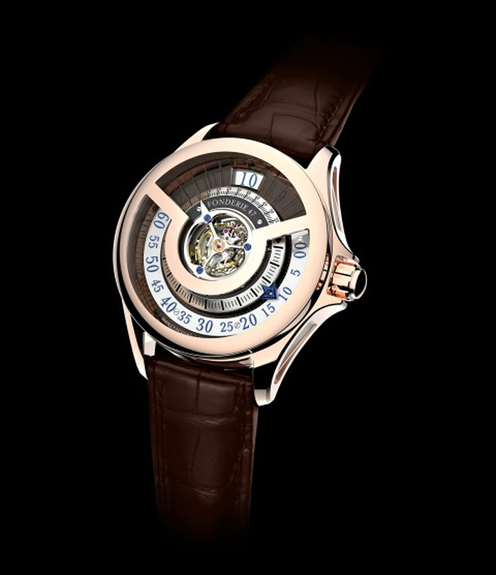 Fonderie 47 unveils the Inversion Principle second edition in rose gold. It features three-dimensional indications rising from the 240° numbers on the flat retrograde minutes ring to the inner inclined minute markers. The blued minute hand has an inclined inner arrow following the angle of the minute marker track.
