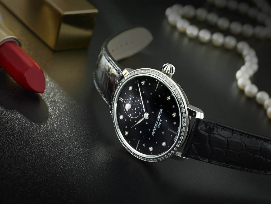 This Frederique Constant Slimline Moonphase Stars Manufacture watch is crafted in stainless steel with a black dial with star motif.