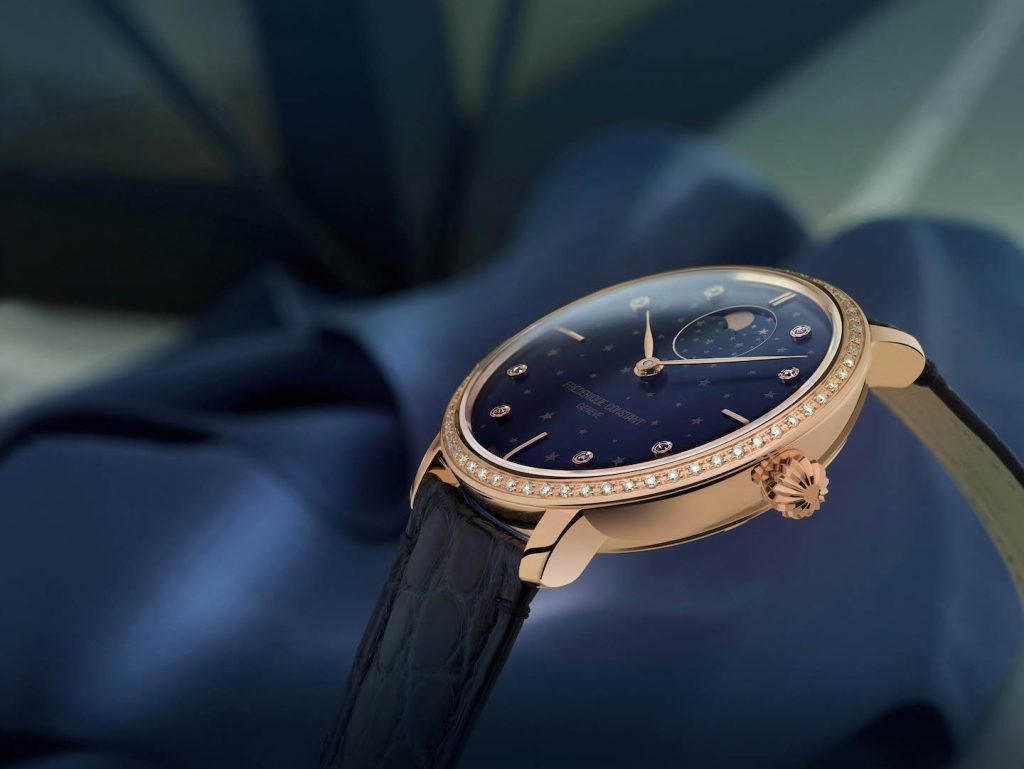 This Frederique Constant Slimline Moonphase Stars Manufacture watch is crafted in rose glottal case with a midnight blue dial with star motif.