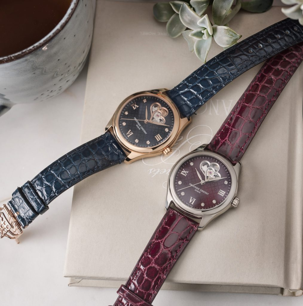 Frederique Constant Ladies Automatic Double Heart Beat watches in burgundy and blue.