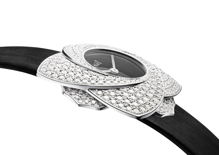 """The watch case """"blooms"""" with a turn -- magically blossoming for day-to-night wear."""