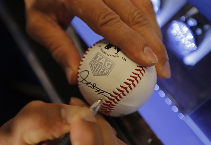 Stanton autographed baseballs at the TAG Heuer event for a host of guests .