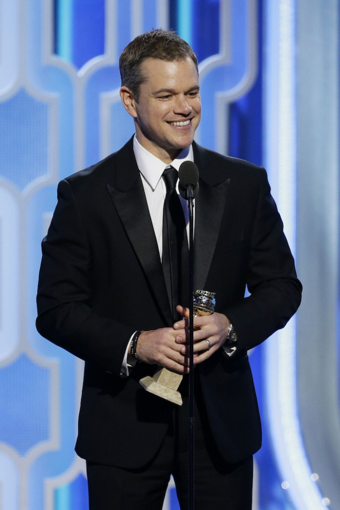 "Matt Damon accepts the award for Best Actor - Motion Picture, Comedy onstage for ""The Martian"" during the 73rd Annual Golden Globe Awards at The Beverly Hilton Hotel on January 10, 2016 in Beverly Hills, California. (Photo by Paul Drinkwater/NBCUniversal via Getty Images). Damon is wearing Piaget Gouveneur watch"