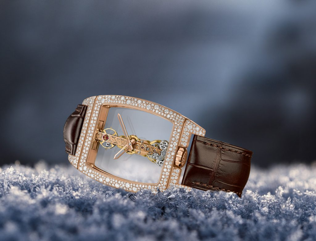 Corum Golden Bridge and Miss Golden Bridge with snow-set diamond cases.