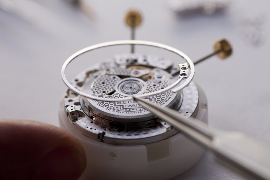The Hermes Impatient Hour watch is built so that the dial does not touch the case sides, enabling the gong to chime with better acoustic output.