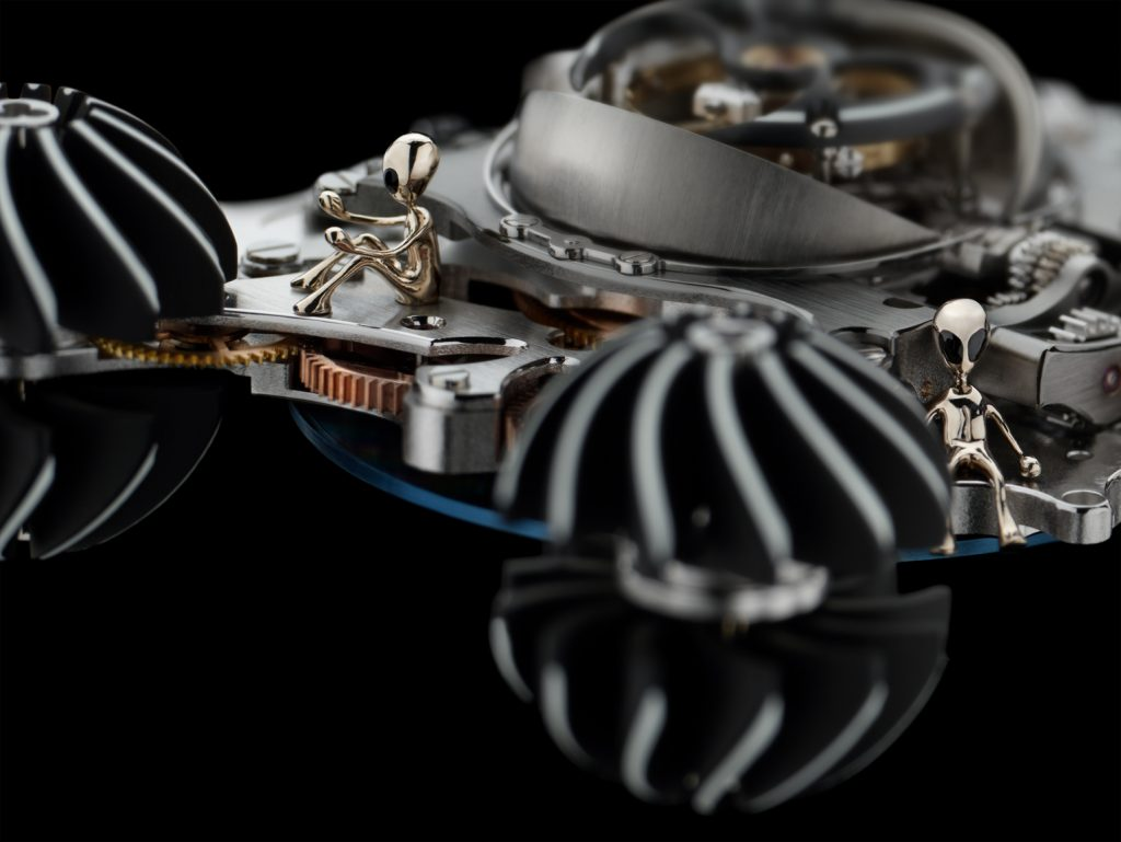 In addition to the pilot alien that sits in the MB&F HM6 Alien Nation case between two of the turbines, there are five more alien crew members inside the watch.