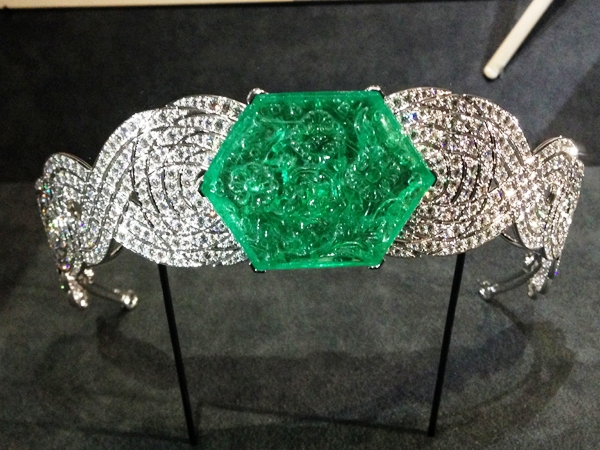 Exquisitely carved emerald and diamond bracelet.