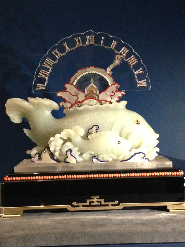 Ornately carved table clock in the likeness of fish for the Asian market. Circa 1925.