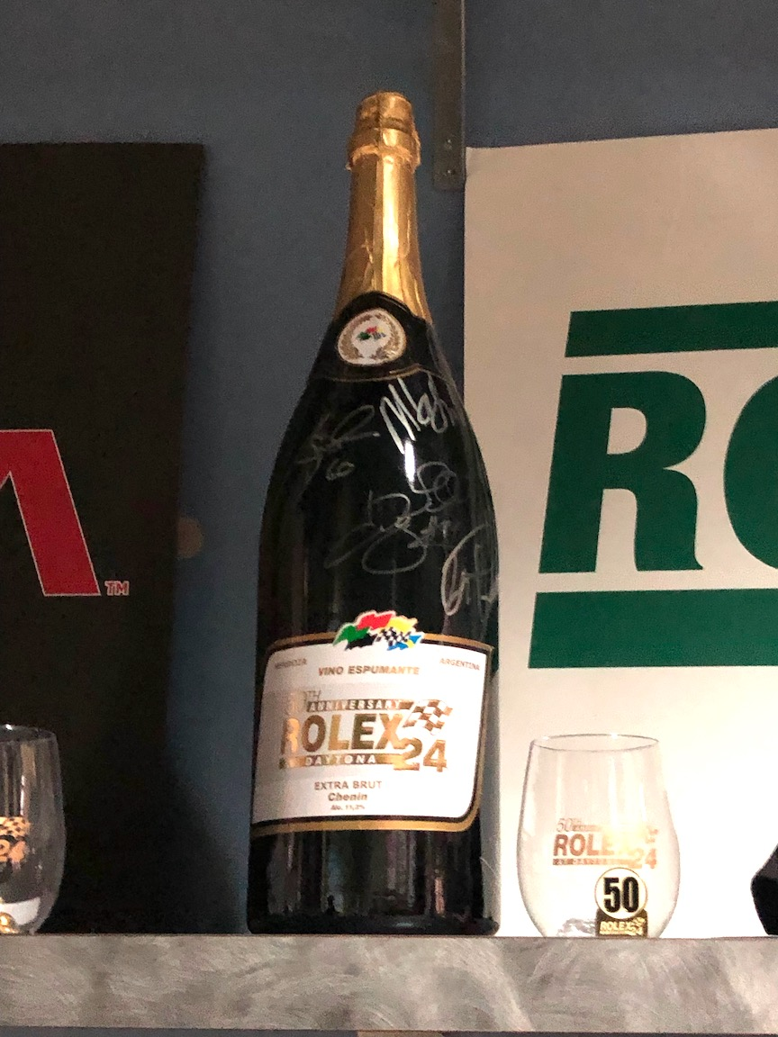 Signed Rolex champagne bottle as