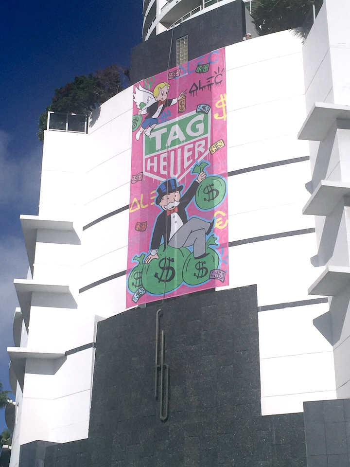 Alec Monopoly scaled the side wall of Fontainebleau Hotel, paining on the multi-story mural along the way.