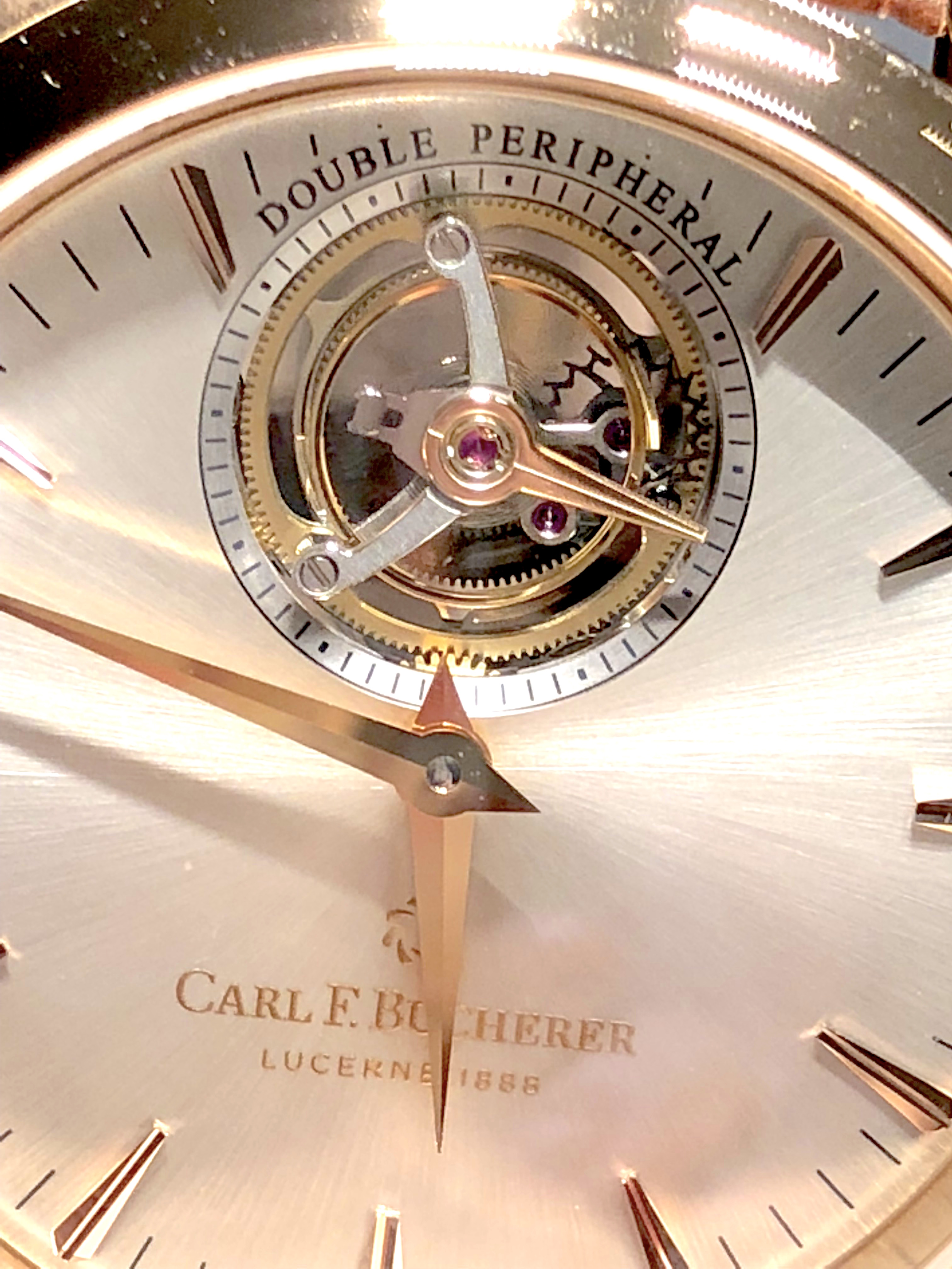 The tourbillon escapement of the Carl F. Bucherer Manero Tourbillon DoublePeripheral watch is peripherally mounted and can be viewed from the dial side and reverse side.