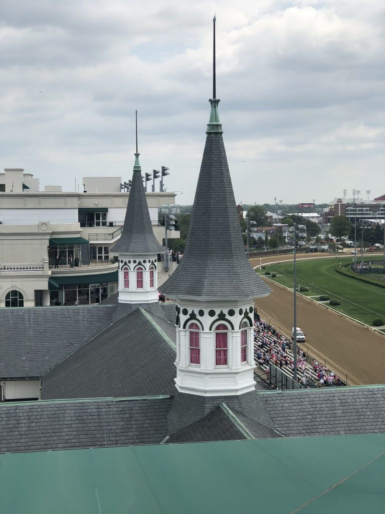 The famous twin spires of Churchill Downs served as a beacon for early derby goers in the late 1800s.