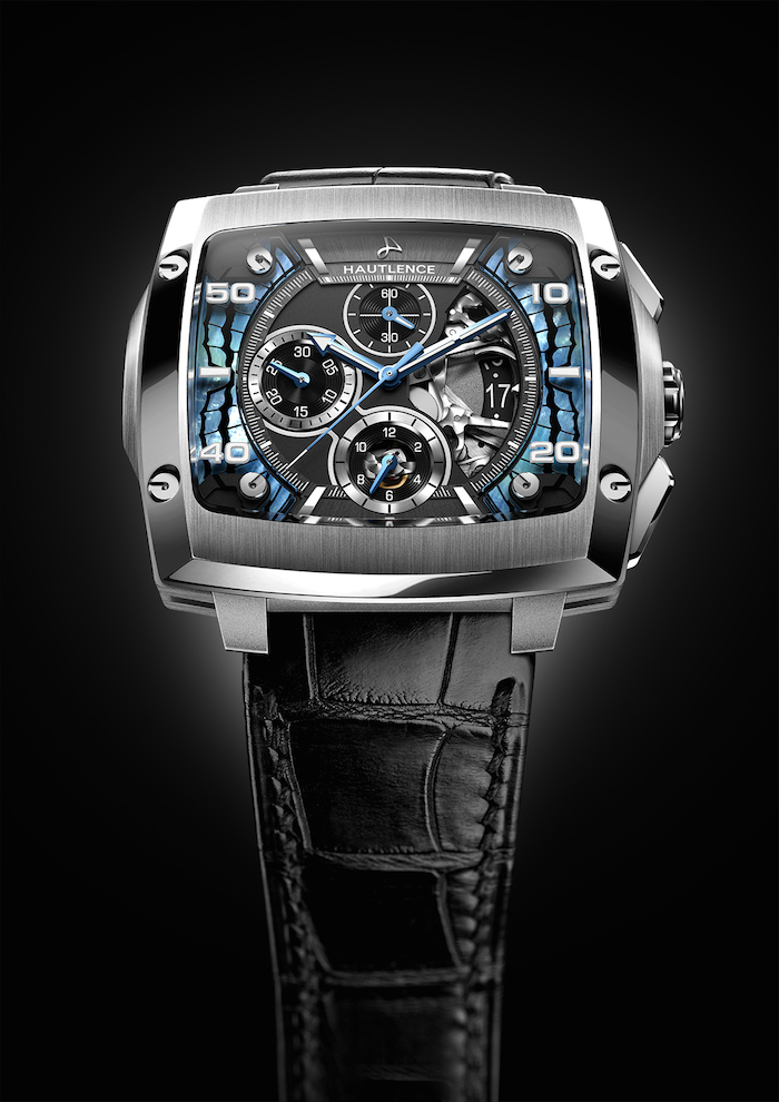 The mother of pearl and blue accents on the dial are inspired by the Invictus butterfly's colors.