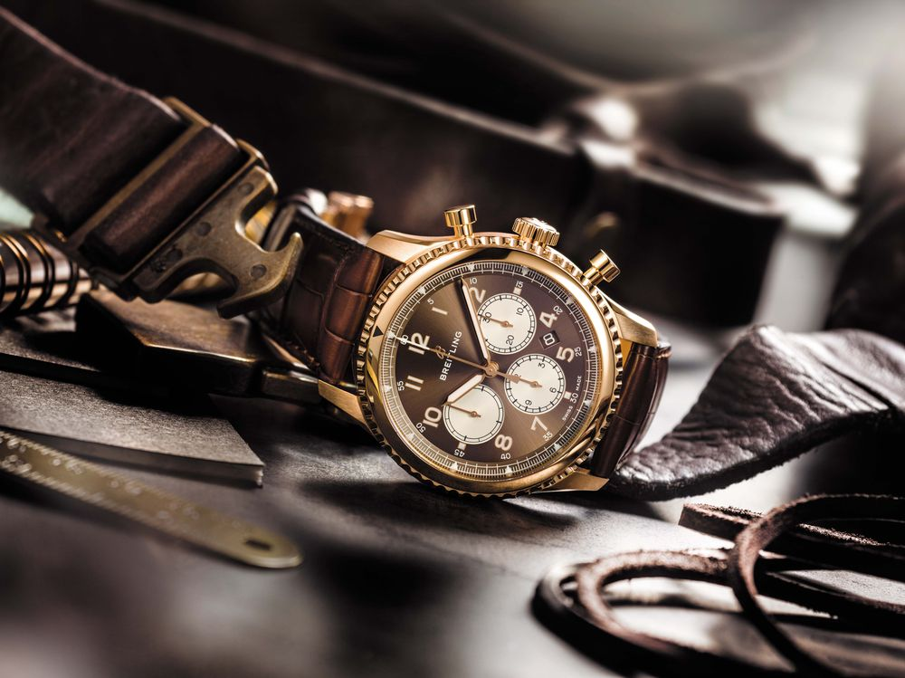 Breitling Navitimer 8 B01 in 18-karat 5N rose gold with bronze dial and alligator strap.