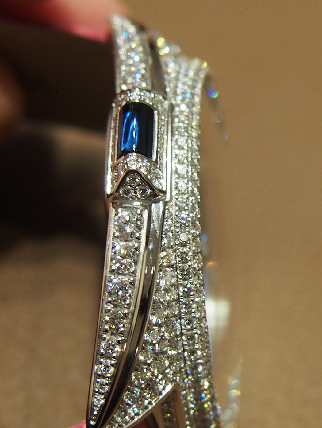 High diamond version of the Cle de Cartier watch from profile view